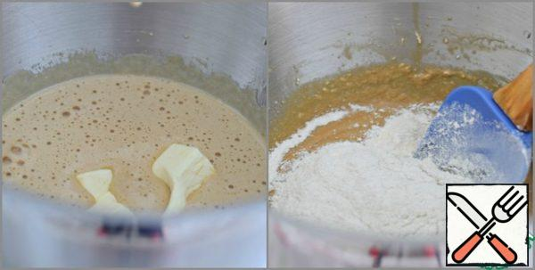 Add the softened butter to the egg-sugar mixture. Whip. Sift both types of flour with baking soda, baking powder and salt. Add the flour mixture to the egg-sugar mixture in parts, stirring gently but thoroughly with a spatula.