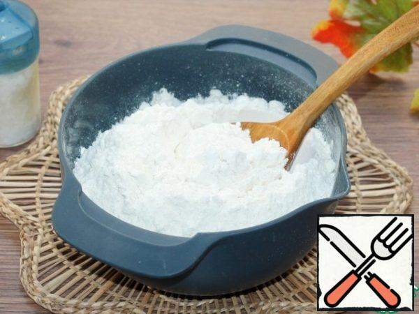 Mix flour (410 g) with salt (1 tsp) and sift.
