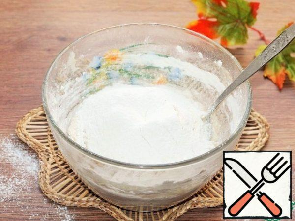 In the liquid mixture, add small parts of flour and knead the dough.