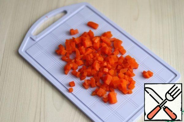 Boil the carrots and cut them into small cubes.
