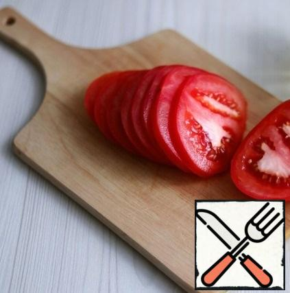 A large tomato or two medium-sized ones, cut into slices.