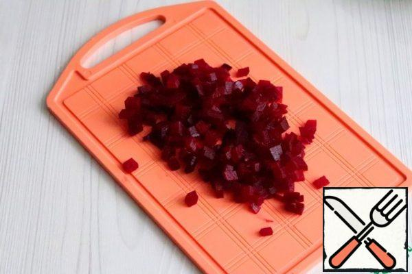 Boil the beets and cut them into small cubes.