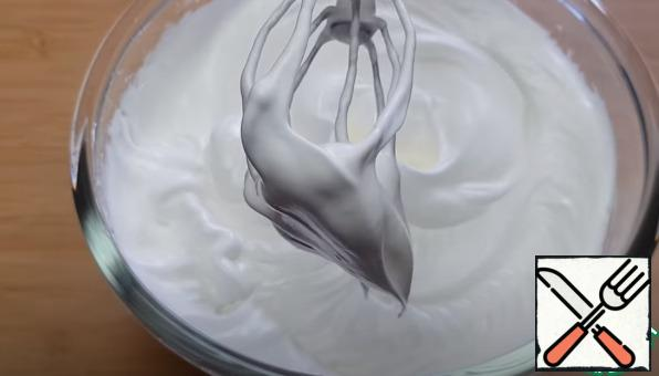 Add a pinch of salt to the whites and beat with a mixer, gradually adding powdered sugar, until stable peaks form.