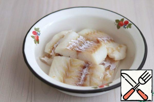 Cod fillet (700 gr.) cut into slices.