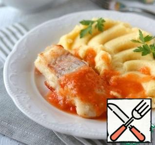 As a side dish, you can serve French fries, mashed potatoes, boiled rice. When serving, pour the vegetable sauce over the fish.Bon Appetit!