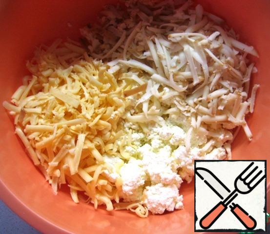 In a bowl, combine cottage cheese, grated hard cheese and smoked Suluguni.