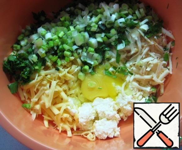Add the egg and finely chopped parsley and dill, green onions.