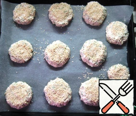 Form balls with wet hands (I got 11 PCs.). Slightly flatten them on a baking sheet, placing them at a sufficient distance (the tortillas will become thin and increase in diameter during baking). Sprinkle sesame seeds on top and send to bake in a preheated 180 oven for 30-35 minutes until Golden.