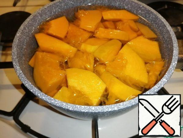 Cut the pumpkin into large pieces, put it in a saucepan, cover with water and boil until tender.