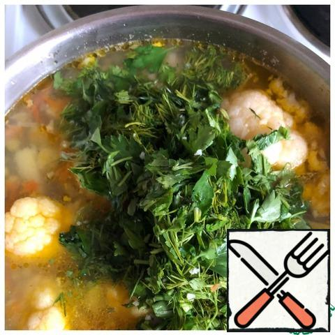 Finely chop the herbs and add to the soup.
