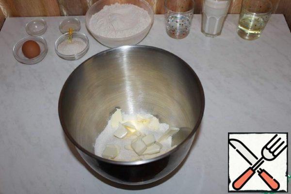 Add sugar and chilled butter to the flour.