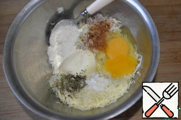 Put the egg, salt, pepper mixture, herbs (I have dry parsley). Add sour cream or mayonnaise, flour or starch.