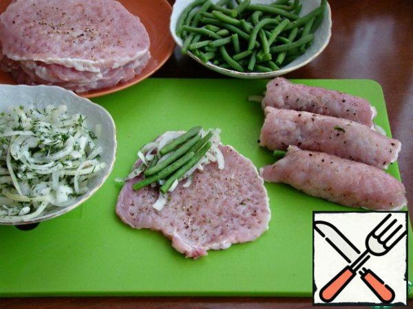 Put a little pickled onion and beans on each meat slice. Wrap in a thick roll.