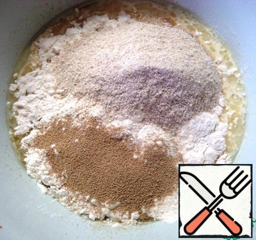 Add sugar, salt, wheat and oat flour, add yeast.