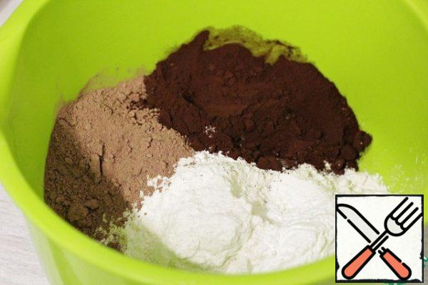 In a large bowl, add the flour, cocoa powder (I have regular and alkalized) and baking powder. Mix well with a whisk.
