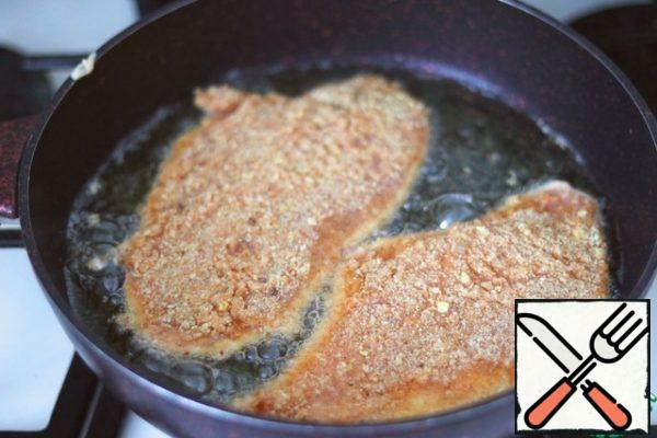 Fry the schnitzels on both sides until browned.