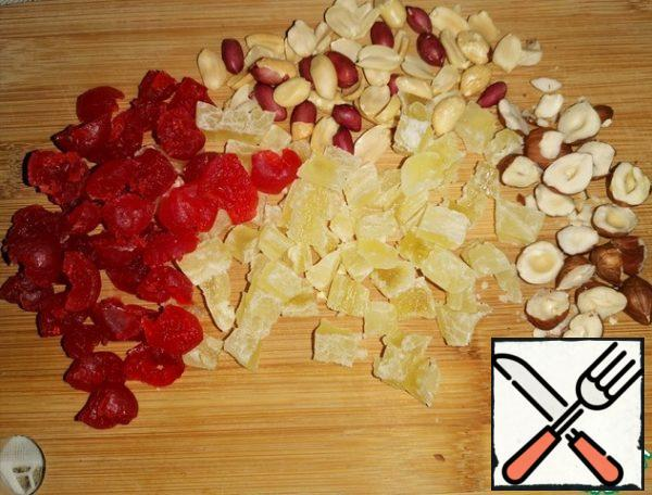 Cupcake products. * Take candied fruits and nuts according to your taste preferences. Cut the cherries and pineapple and chop the nuts.