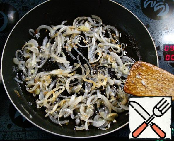 Then in the same pan fry the onion, chopped into strips.