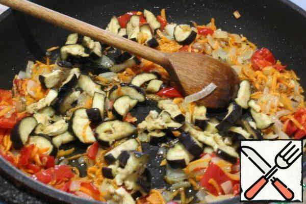 Add the eggplant and fry.