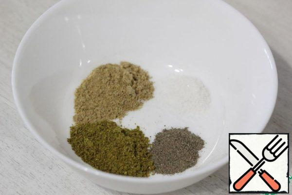 In a small bowl, put the salt, utsho-suneli, hops-suneli and black pepper.
