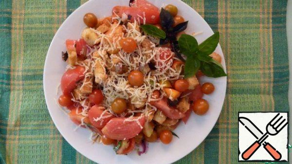 Mix all the ingredients of the salad. Top with grated cheese and Basil sprigs.