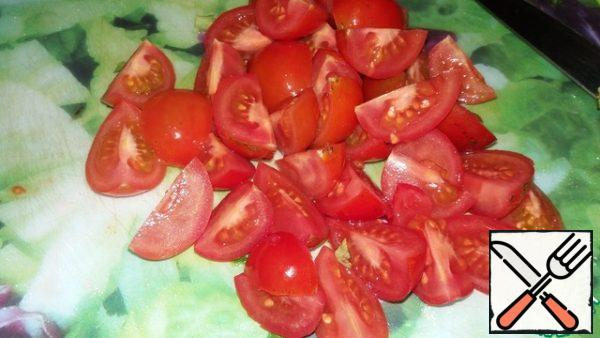 Cherry tomatoes cut into halves or quarters.