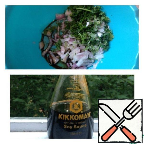 Finely chop the greens as well as the onion. Place in a bowl and add the spices, soy sauce, sugar and vinegar. Mix well.