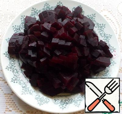 Boil or bake beets. Cool and finely chop.