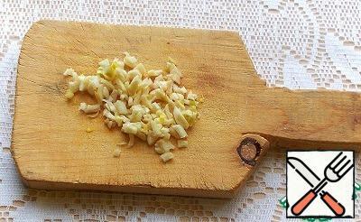 Chop the garlic.