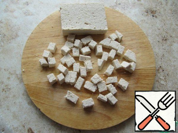Cut tofu cheese into cubes.