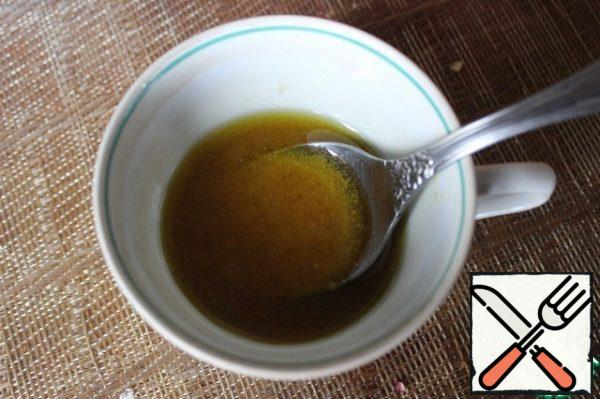 Mix the olive oil, mustard, and vinegar into a smooth emulsion. Dress the salad!