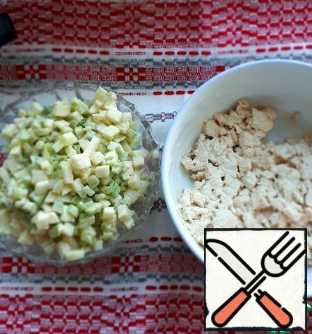 Add half of the dressing to the chicken fillet, and half to the celery and Apple.