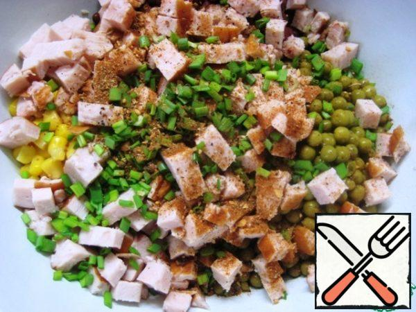 Add finely chopped green onions and season with a mixture of peppers and spices.