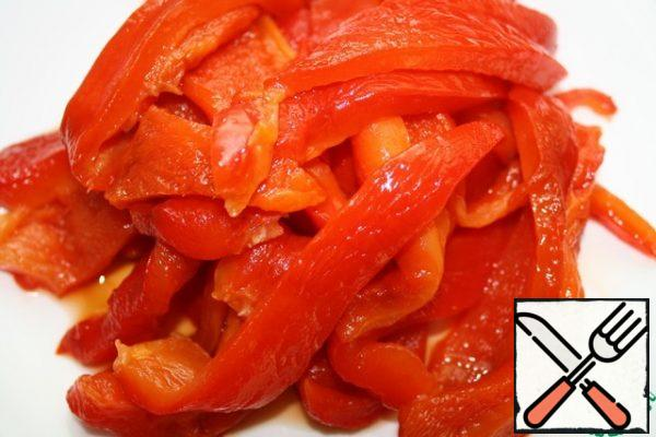 Bake the pepper at temp. 200 deg for about 45 minutes. Remove the skin, remove the seeds and cut into strips.