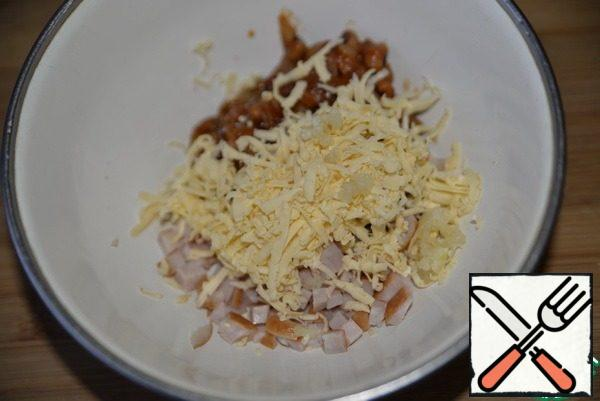 Add the grated cheese and squeeze out the garlic.
