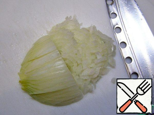 Very finely chop the onion.