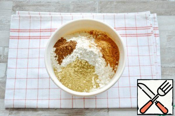 Sift the flour into a bowl, add the spices and baking powder, and whisk everything together.