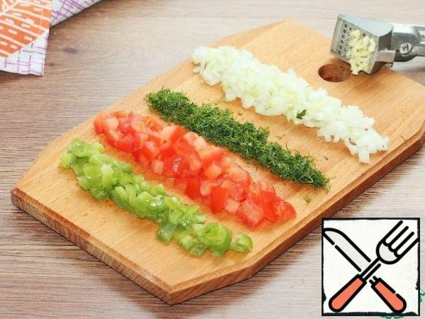 Cut the prepared vegetables and mushrooms into small cubes and finely chop the dill.