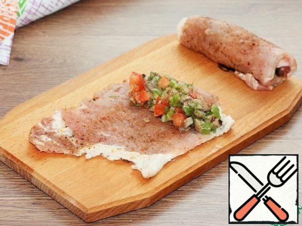 Then put the filling and roll the chop into a roll.