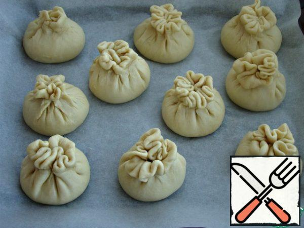 Smear the prepared samsa with egg and put it in a preheated 180* oven for 30 minutes ( use your oven)
