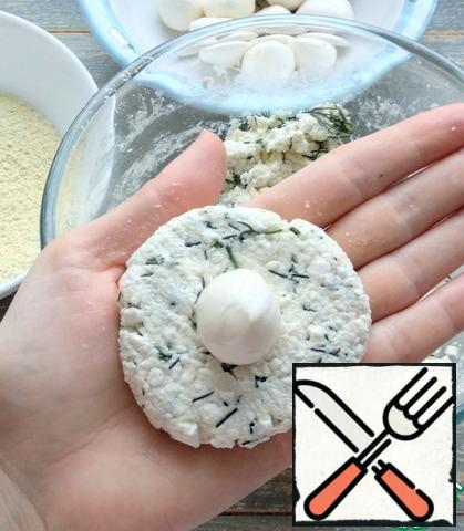 1 tbsp cottage cheese mixture to form a pellet. Put a ball of mozzarella in the middle.