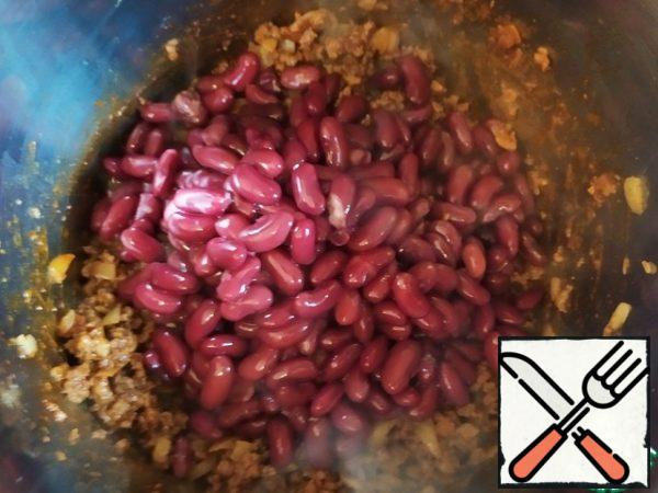 Add the beans and stir.