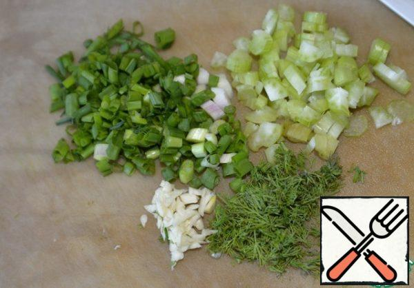 Finely chop the celery stalk, green onion, dill and garlic.