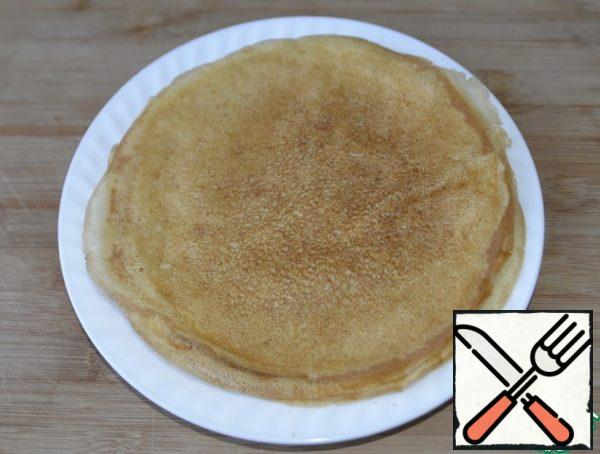 To prepare a snack, you can use any unsweetened pancakes according to your favorite recipe. There are a lot of recipes on the site.