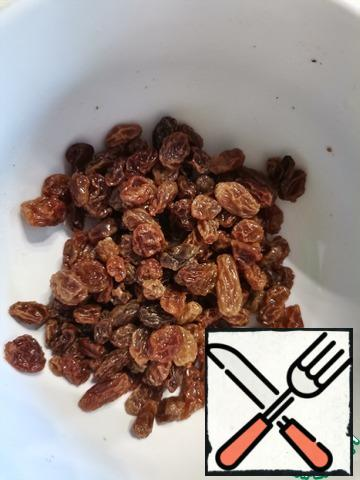 Wash raisins and pour boiling water for 15 minutes. Then dry it.