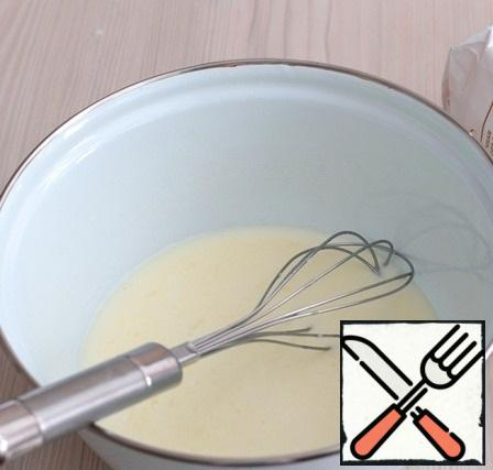 Beat the mixture with a whisk. Then add 200 ml of warm milk.