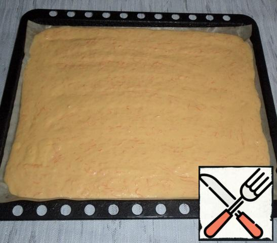 Spread the carrot dough on a baking sheet covered with parchment or a Teflon / silicone Mat. Evenly distribute the dough.