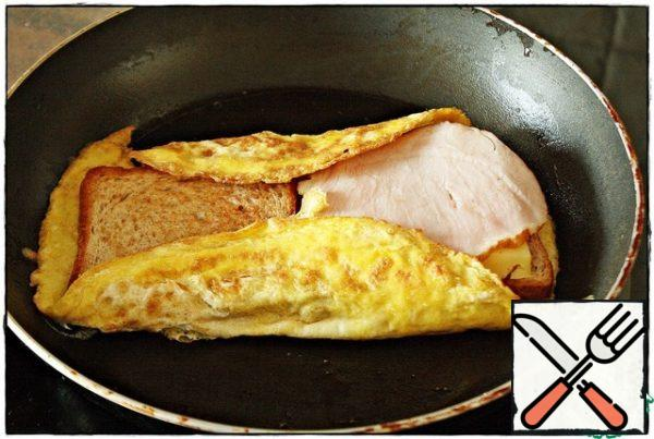 Again folded around the edges of the omelet with a spatula pressing.