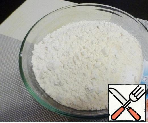 Add semolina, salt, baking soda and baking powder to the flour. Be careful with salt, if the cheese is salty, you can add less.