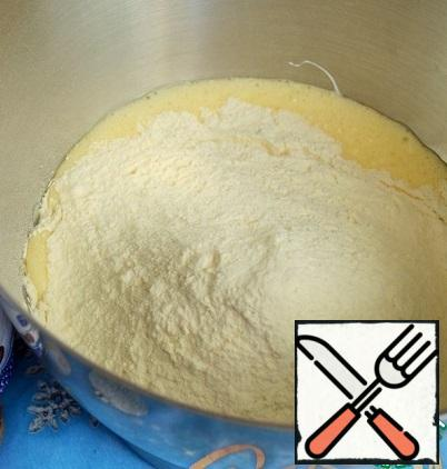 Add the flour to the liquid mass.